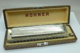 A Hohner 'The 64 Chromonica' Professional model harmonica, boxed