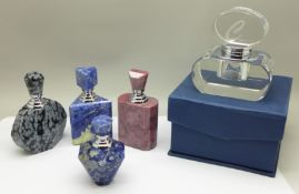 A collection of five perfume bottles, boxed