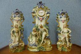 A continental bisque porcelain quartz clock garniture