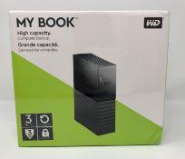 A boxed as new Western Digital My Book 3TB Desktop Hard Drive (Box sealed).