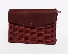 An as new Wicker Wings minis shoulder bag in burgundy.