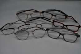 Seven pairs of as new glasses frames with clear glass to include Charles Stone, Vulkan and Opera (