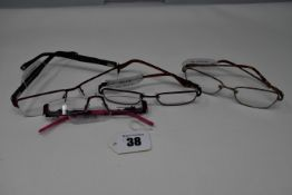 Four pairs of as new glasses frames with clear glass; Serge Blanco, Opera, Humphrey's and Zoffani (