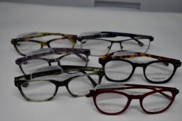 Six pairs of as new glasses frames with clear glass to include Charles Stone and Serge Blanco (