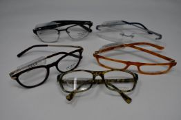 Five pairs of as new glasses frames with clear glass to include Yous, William Morris, Wolf and