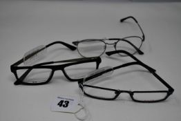 Three pairs of as new glasses frames with clear glass; Dutz, P+US and Convertibles (RRP £150 each).