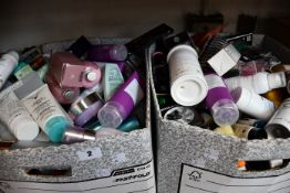 Two boxes of as new/pre-owned toiletries.