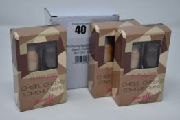 Twelve boxes of three sets of BarryM Flawless Chisel Cheeks contouring highlighting creams.
