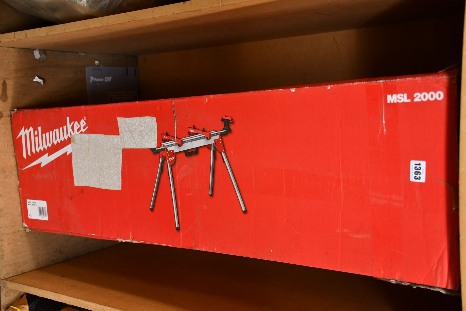 Lot 1363 - An as new Milwaukee MSL2000 mitre saw stand (Opened and damage to box).