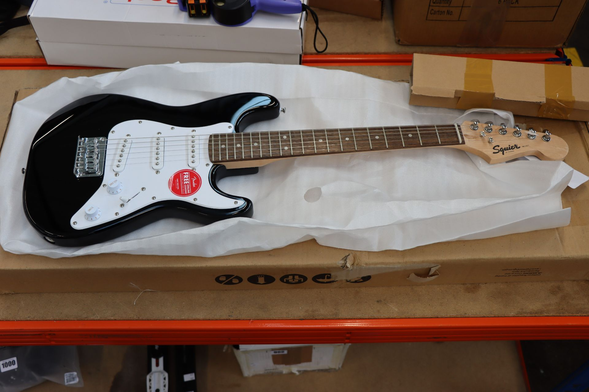 Lot 996 - One boxed as new Fender Squier Mini Strat in black and white.