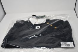 An as new Ralph Lauren ladies black jumper with attached shirt and shoulder buttons (M).
