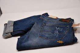 A pair of as new Ralph Lauren Polo Sullivan slim St Andrews blue jeans (Size 36 x 34).