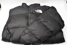 An as new North Face Iconic Nuptse retro down feather black puffer coat (Size L).
