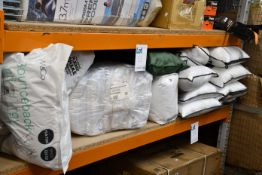 A quantity of assorted pillows, bedding and related items.