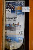 "A boxed Intex prism frame premium pool set (12' x 30"")."