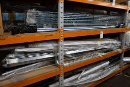 A shelf of miscellaneous items to include plastic tubing and metal support brackets.