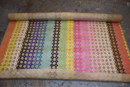 One handmade woven rainbow seagrass fibre rug.