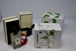 One Jo Malone English Pear & Freesia body and hand wash (250ml), one Jo Malone Red Roses body and