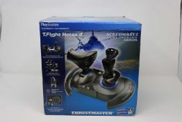 A pre owned boxed Thrustmaster T.Flight Hotas 4 PS4 Joystick - Ace Combat 7 Skies Unknown Edition (