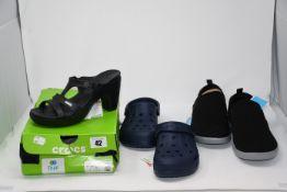 One as new Crocs Women's Cyprus V Heel size 6. One as new Crocs baya navy size UK 5. One as new