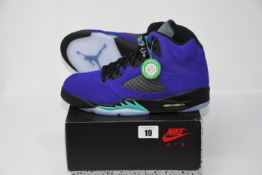 One pair of as new Jordan 5 Alternate Grape Black size UK 9.