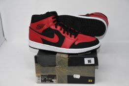 One pair of as new Air Jordan 1 Mid black/gym red-white size 10.5.