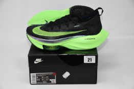 One pair of as new Nike Air Zoom Alphafly Next% size UK 7 (CI9925-400).