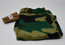 One as new Burberry camouflage print ramie cotton cargo trousers size 10 (R.R.P. £250. some marks on
