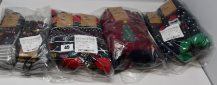 Twelve as new M&Co Christmas three socks pair. Twelve pairs of as new M&Co Ho Ho Ho Christmas socks.