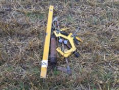 Clamps, spirit level and grease gun