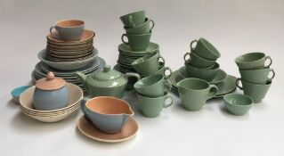 A Woods ware part tea set; together with a quantity of Poole pottery, to include plates, bowls,