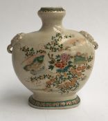 An antique Japanese Meiji period enamelled vase with elephant lugs, decorated with views of Mount