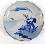 Japanese sometsuke blue and white plate, decorated with a scene of a house and tree beneath