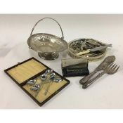 A small mixed lot of plated items, to include a quantity of flatware, swing handled basket, decanter