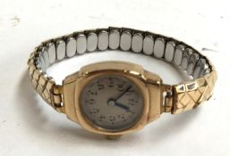 9ct gold ladies watch with metal strap (engraving on the back)