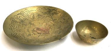A Chinese brass bowl with dragon design interior, 27cmD; together with a smaller Chinese brass bowl,