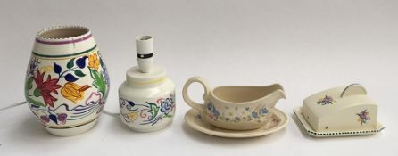 A Poole Pottery 'Springtime' gravy boat and stand; vase, 20.5cmH; Poole Pottery lamp; and a Poole