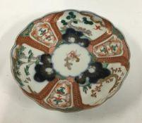 A Japanese Imari plate, sen-gaki pattern, heightened in gilt, made in Hizen region, 21.5cmD