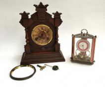 A carved American mantel clock (af), with key and pendulum, marked Ansonia Clock Co. New York;