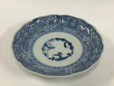 A Japanese Imari plate, sho-chiku-bai pattern, edo period, made in Hizen region, 24cmD