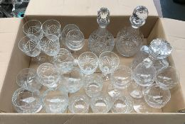 A mixed lot of cut glassware, to include three decanters, whiskey tumblers, wine glasses, etc