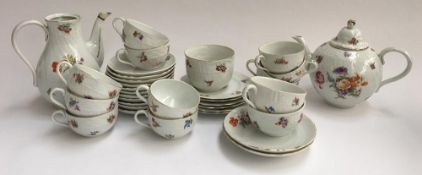A Czech floral tea set heightened in gilt