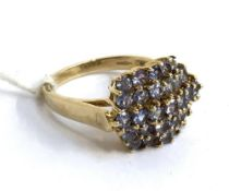 A 9ct gold cluster ring set with pale purple stones, 4.9g