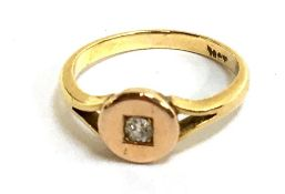 A pretty 18ct ring (hallmarked rubbed but tested)set with small diamond, gross weight 2.8g, size L