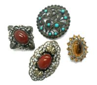 Two hardstone white metal brooches together with 2 others