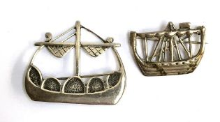 Two silver brooches in the form of ships, one marked Iona, Scotland