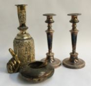 A pair of plated candlesticks, with removable bobeches; together with an Indian bowl, and Eastern