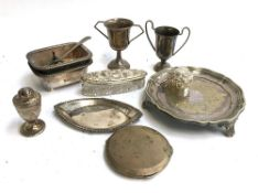 A mixed lot of silver and plated items, to include small silver trophy cup, silver topped dressing