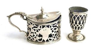 A silver salt with blue glass liner, Chester 1911, and a silver pepper with liner, by Boardman,