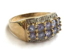 A 9ct gold ring set with purple stones and zircons, 3.8g